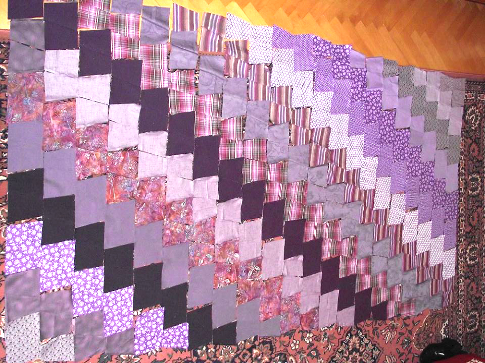 Lila patchwork takaró